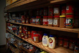 shelves of a food bank are filled with donations